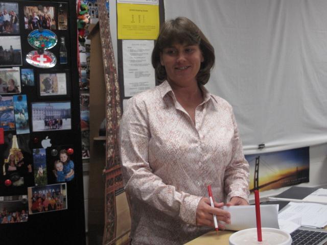 Mrs. Kim Lignoul