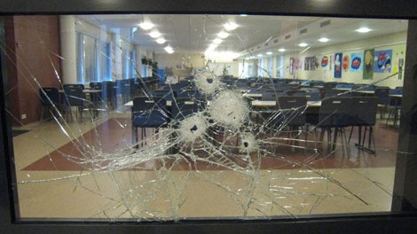 Photo released by Finland's National Bureau of Investigation shows bullet holes in a glass panel on the first floor of the Jokela high school in Finland.-Lehtikuva via AFP/Getty Images