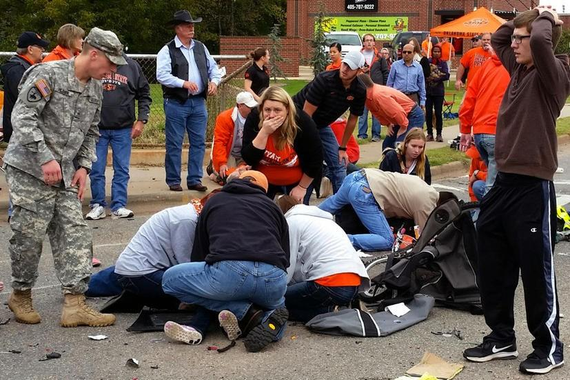 Bystanders+help+the+injured+after+a+vehicle+crashed+into+a+crowd+of+spectators+during+the+Oklahoma+State+University+homecoming+parade%2C+causing+multiple+injuries%2C+on+Saturday%2C+Oct.+24%2C+2015+in+Stillwater%2C+Oka.++%28David+Bitton%2FThe+News+Press+via+AP%29+MANDATORY+CREDIT